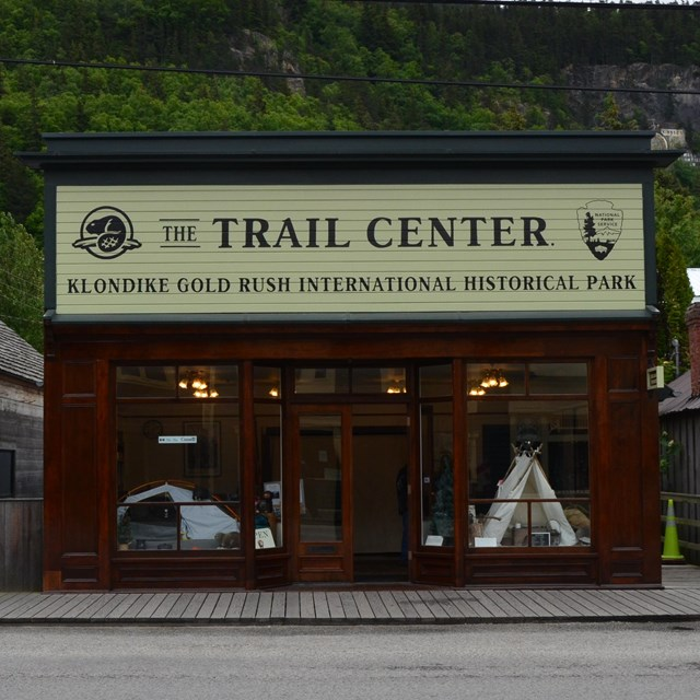 A building with a lustrous wood finish and sign Trail Center
