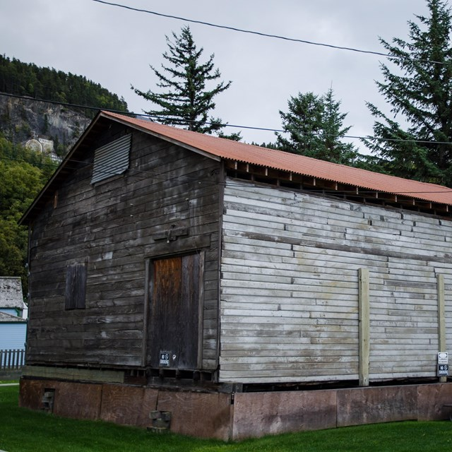A weathered wooden building with metal roof