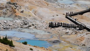 Hikers on the boardwalk in Bumpass Hell basin