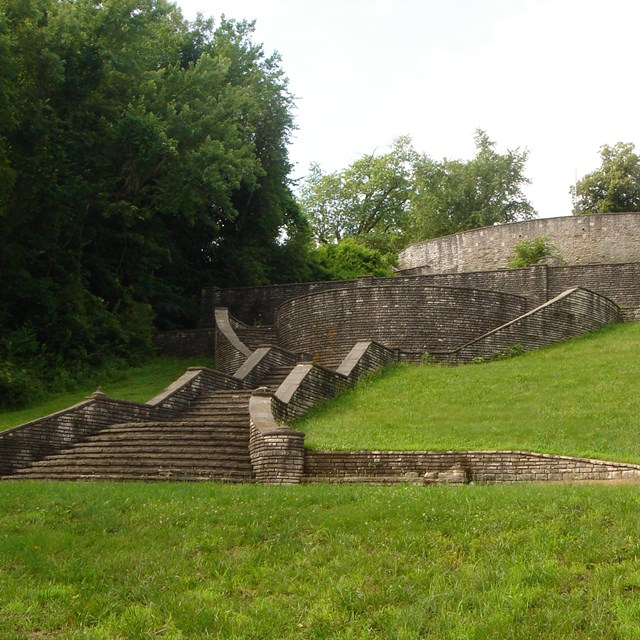 Stone stairs on grassy hill