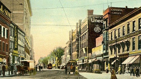 An historic postcard of downtown Lowell