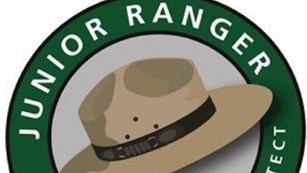 Computer graphic of NPS flat hat surrounded by text
