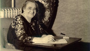 Picture of Maggie L. Walker in a chair with an attached desk