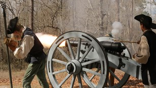 Minute Men firing a cannon.