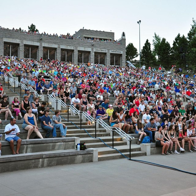 Photo of the audience gathered in the amphitheater at Mount Rushmore.