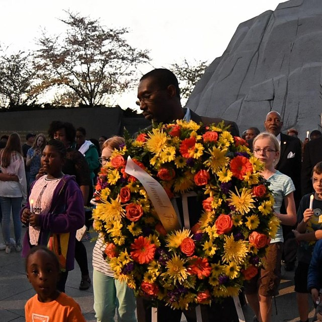 People carrying a wreath near the Martin Luther King, Jr. Memorial