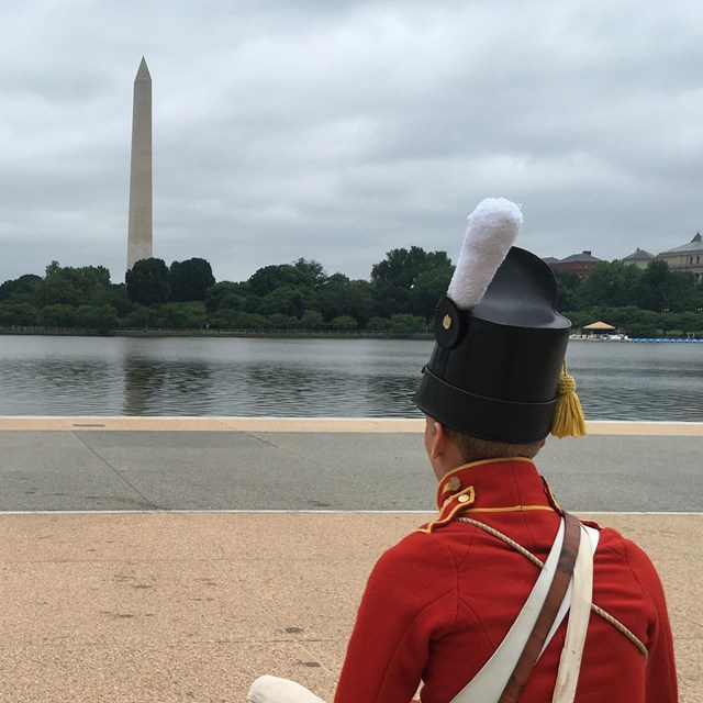 Two US Army Fife and Drum Corps soldiers looking at the Washington Monument