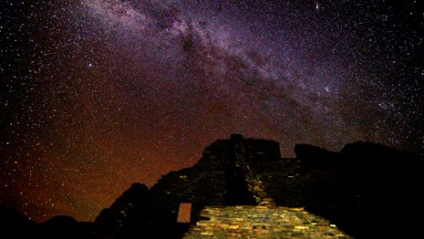 Night sky view of Milky Way above Puebloan ancestral ruins.