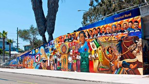 Latino-themed mural on a street