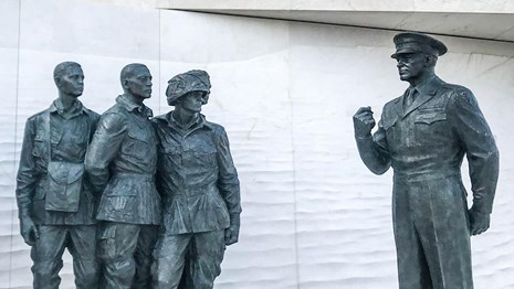 Statue of Dwight D. Eisenhower talking to soldiers