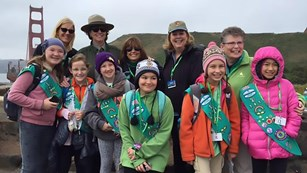 Group of Girl Scouts and National Park Service staff near the Golden Gate Bridge