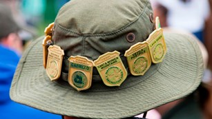 Hat lined with Junior Ranger badges