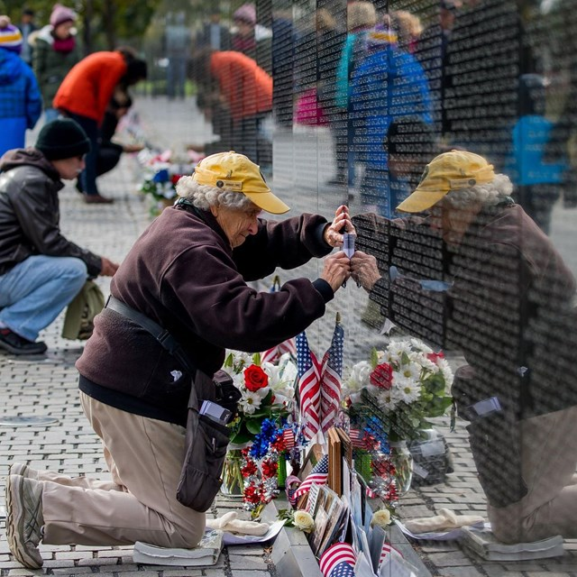 Volunteer cleaning the Vietnam Veterans Memorial wall