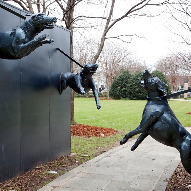 Statue of attack does snarling at each other across a sidewalk