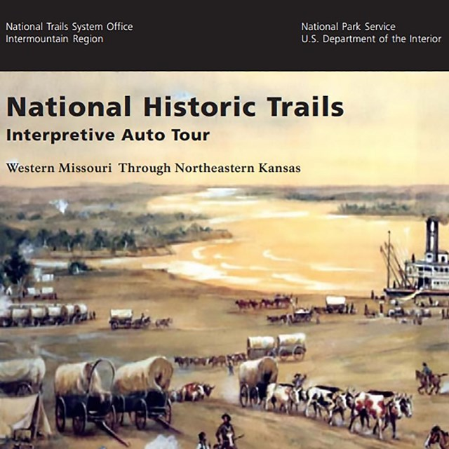 The cover of an auto tour route guide, with an illustration of wagons traveling towards the river.