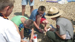 Ranger conducts program with kids on the gravel bar