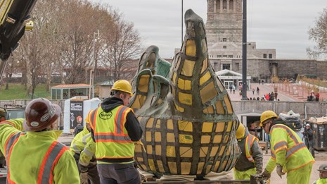 The original torch from the Statue of Liberty is readied to move.