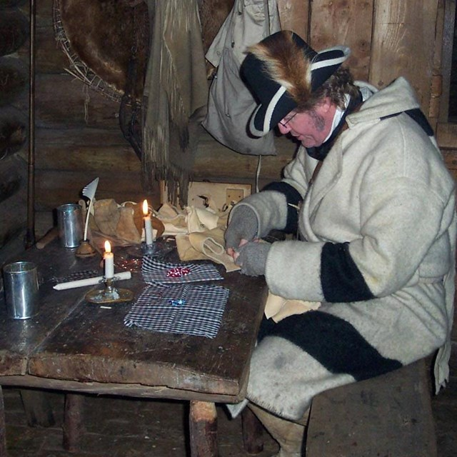Reenactor preparing for trading in a fort