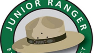 A digital image of a park ranger hat under a banner reading,