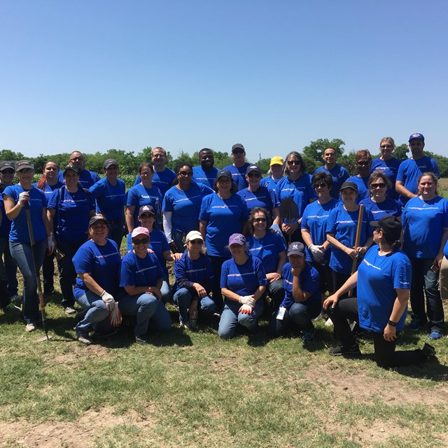 Volunteer group from Southwest Airlines poses for a group photo at San Antonio Missions NHP.