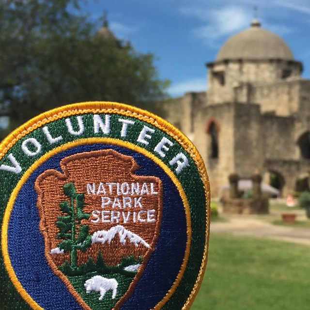 Volunteers staff the mission sites and interpret history to the public.