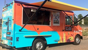 Bright colored food truck.