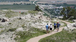 A group of hikers heads out to an overlook on one of the Summit trails.