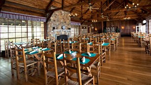 High ceilings, large windows and rustic furniture at the Spottswood Dining Room at Big Meadows.