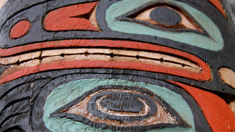 A close up of a totem carving