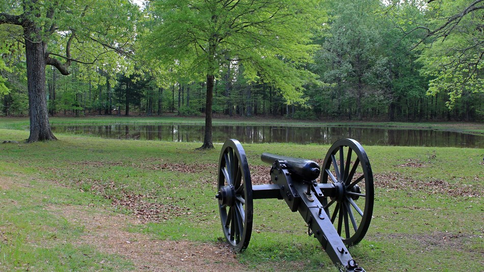 Cannon next to pond and trees, Shiloh, TN