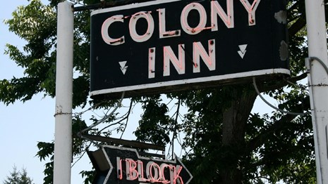 neon sign for the colony inn, which once operated in the amana hotel