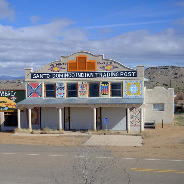 Two historic store fronts in a desert setting.
