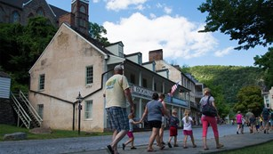 Image of visitors walking in Lower Town of Harpers Ferry National Historical Park.