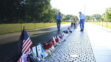 A man walks by the Vietnam Veterans Memorial