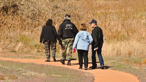 Photograph of visitors walking the park trail
