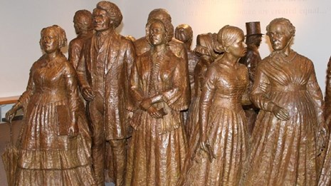 Bronze statues of Frederick Douglass and suffragists. NPS photo