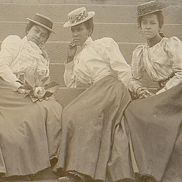 Four black women sitting together. Library of Congress photo.