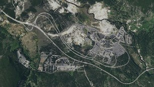 Satellite view showing the main roads and facilities around Old Faithful Geyser.