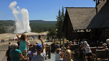 Watching Old Faithful erupt from the deck of the Old Faithful Inn