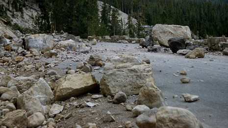 Rocks cover the Grand Loop Road near Gibbon Falls after an earthquake.