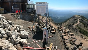 Construction going around around an old, concrete fire lookout.
