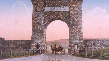 Historic colorized photograph of horses going under a large stone arch.