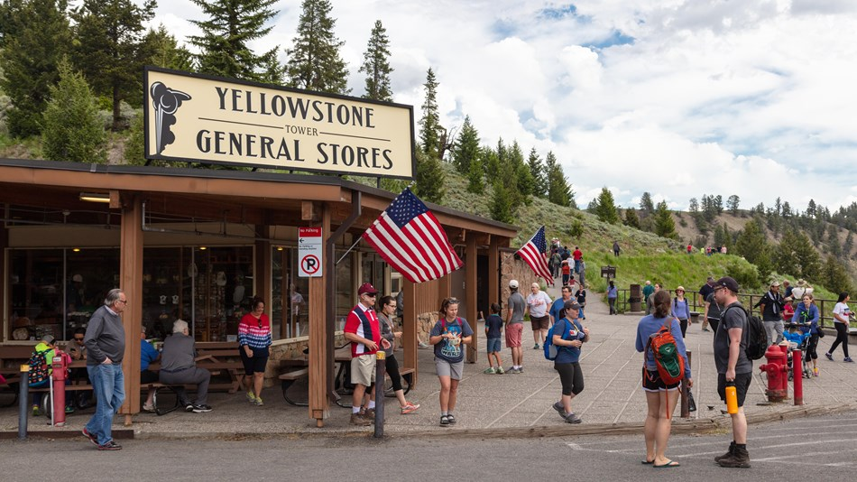 A group of people in front of the Tower Fall store in Yellowstone