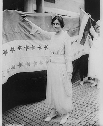 Alice Paul raises a glass after the 19th Amendment passes. Library of Congress