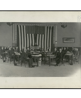 Group of men seated, facing the camera. Courtesy Alaska State Library.