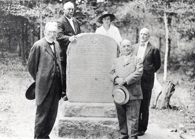 Virginia Dare marker in 1896 with five men and one woman standing around it