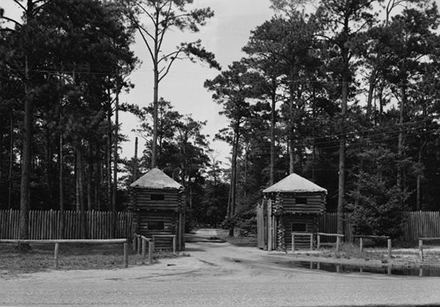 Fort Raleigh entrance showing two log blockhouses, 1930s