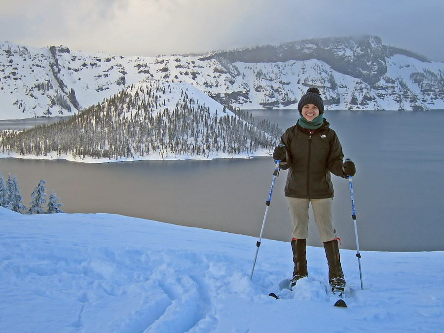 A Skier Stands on the Rim of Crater Lake
