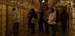 Visitor during the evening tour of Alcatraz gaze into the many cells that line up the corridor known as