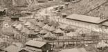 A view of daily life in the barracks, tents and barbed wire enclosure at Honouliuli Internment Camp. c. 1945